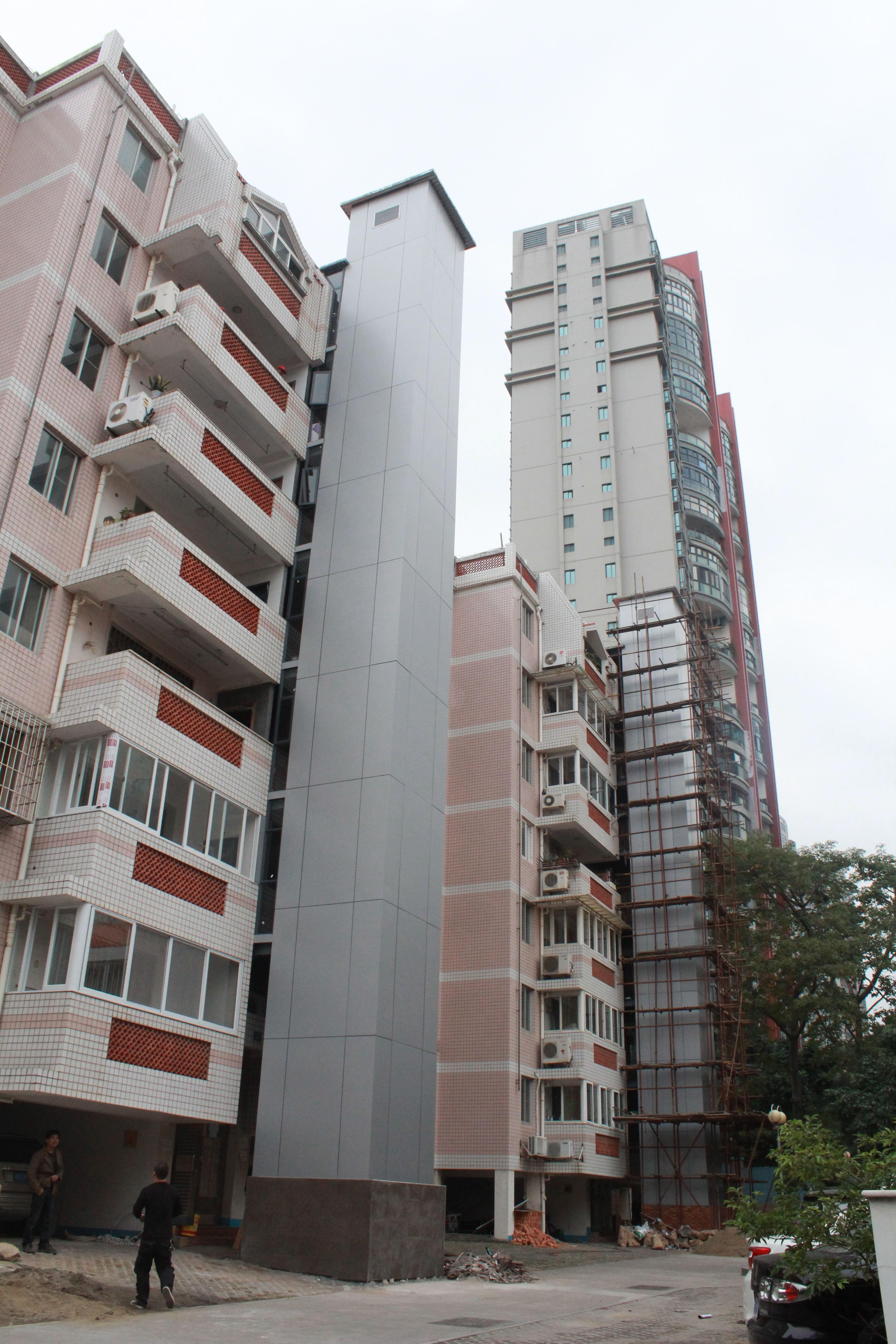 首页 旧楼电梯加装 钢结构铝塑板幕墙 电梯 洪文六里41,42号