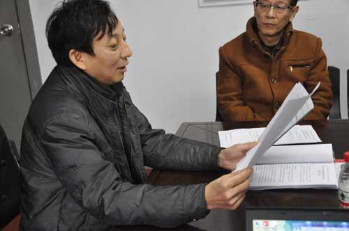 總經理牛光生宣布十項決議的表決結果.jpg